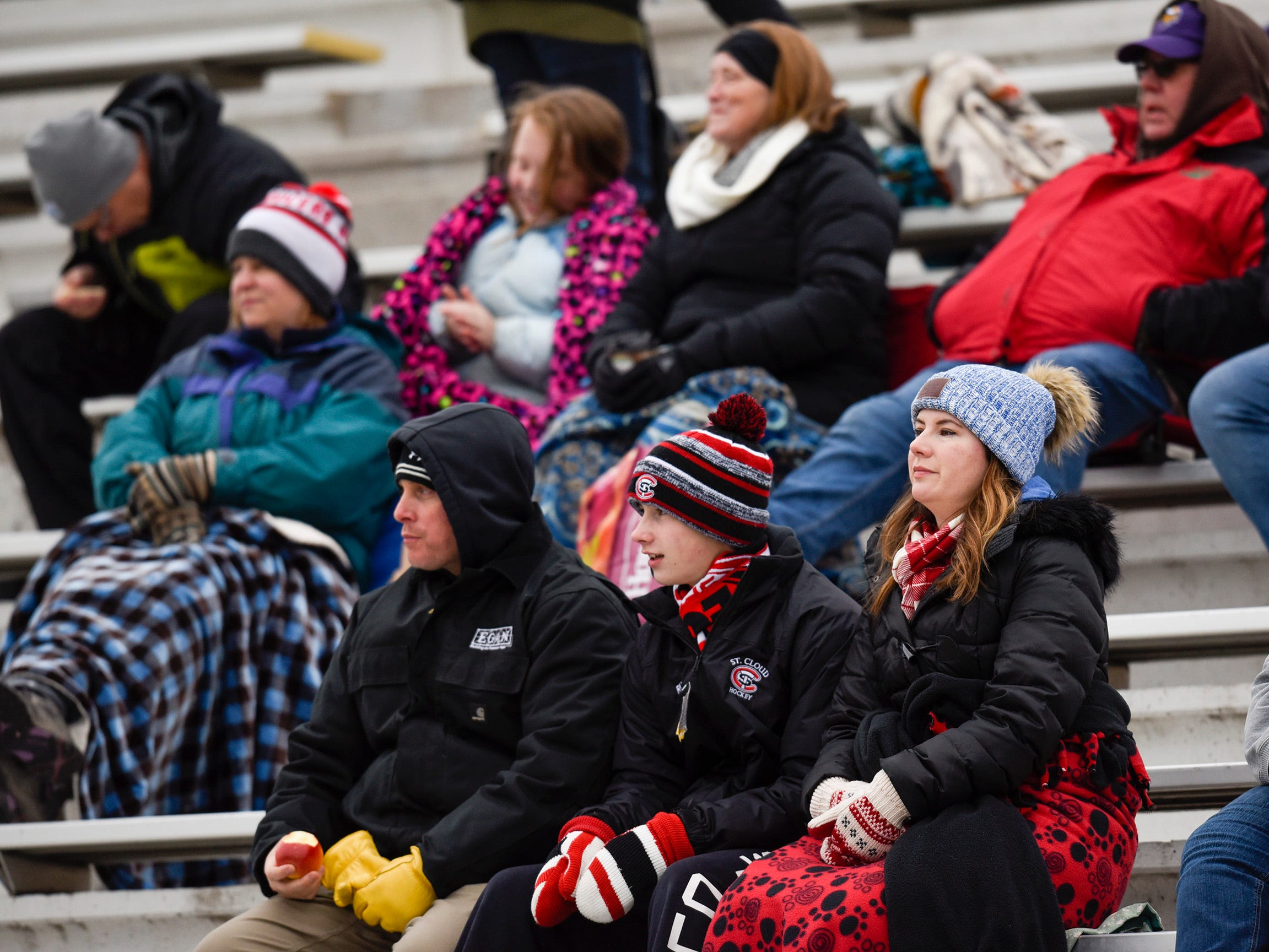 Fans try to stay warm watching the match Thursday, Oct. 11, at Apollo High School.