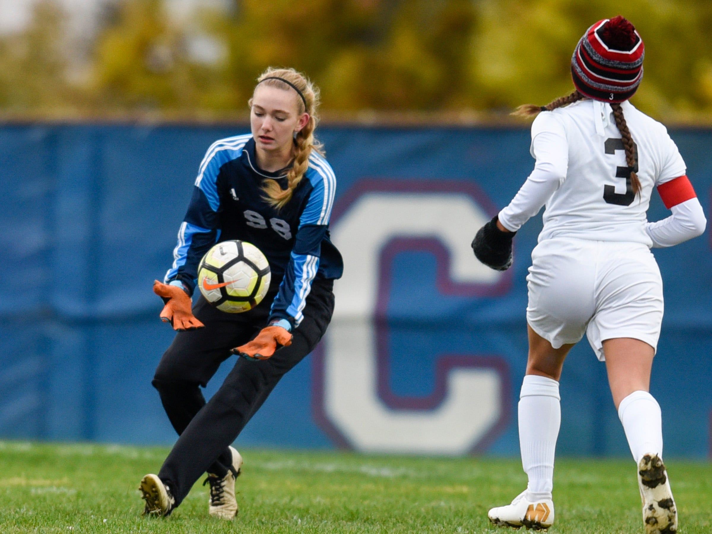 Apollo goalie Megan Vasek makes a stop against ROCORI during the first half Thursday, Oct. 11, at Apollo High School.