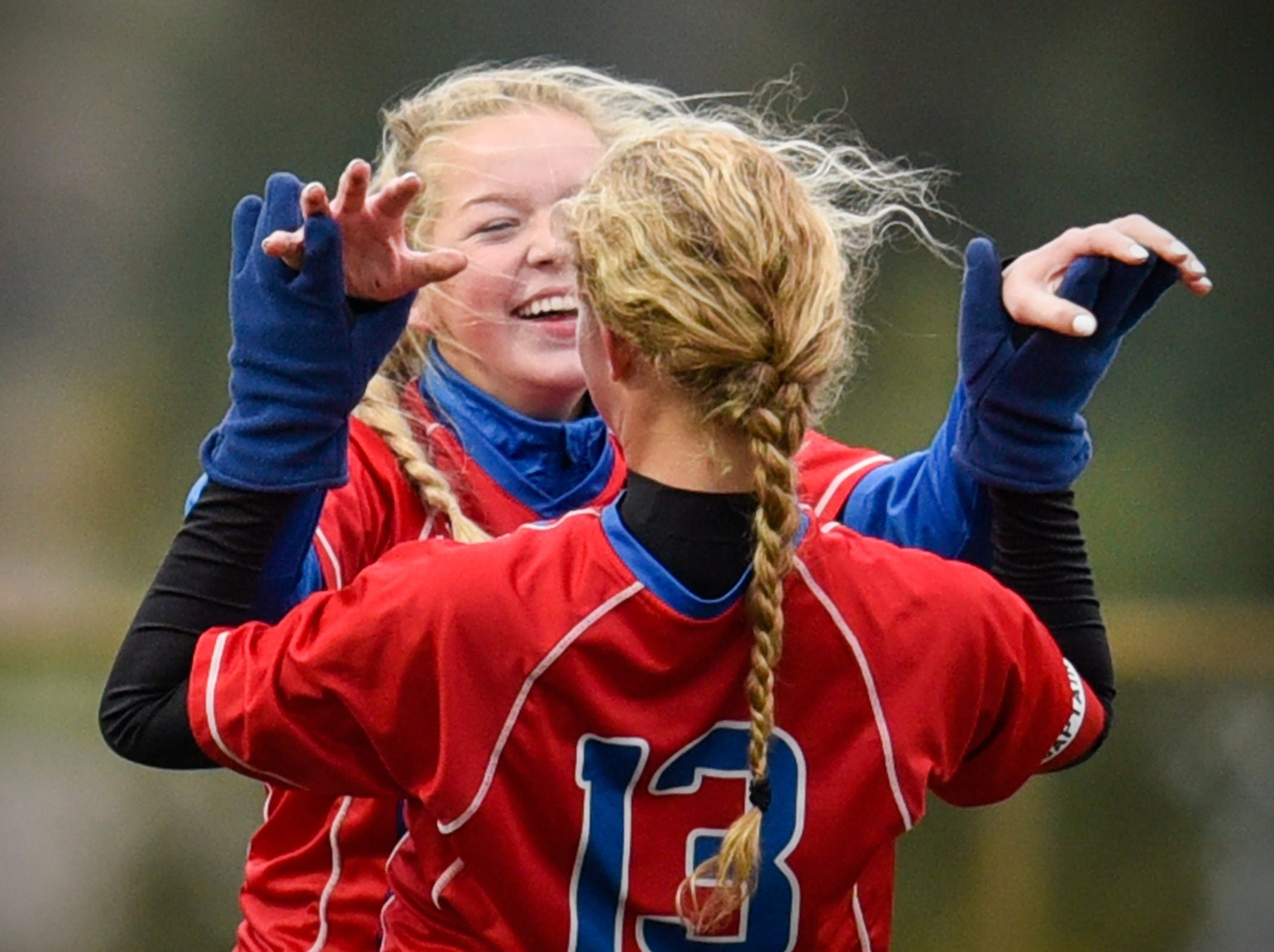 Apollo's Sofie Streich celebrates her second  goal with Jessica Timpane against  ROCORI during the first half Thursday, Oct. 11, at Apollo High School.