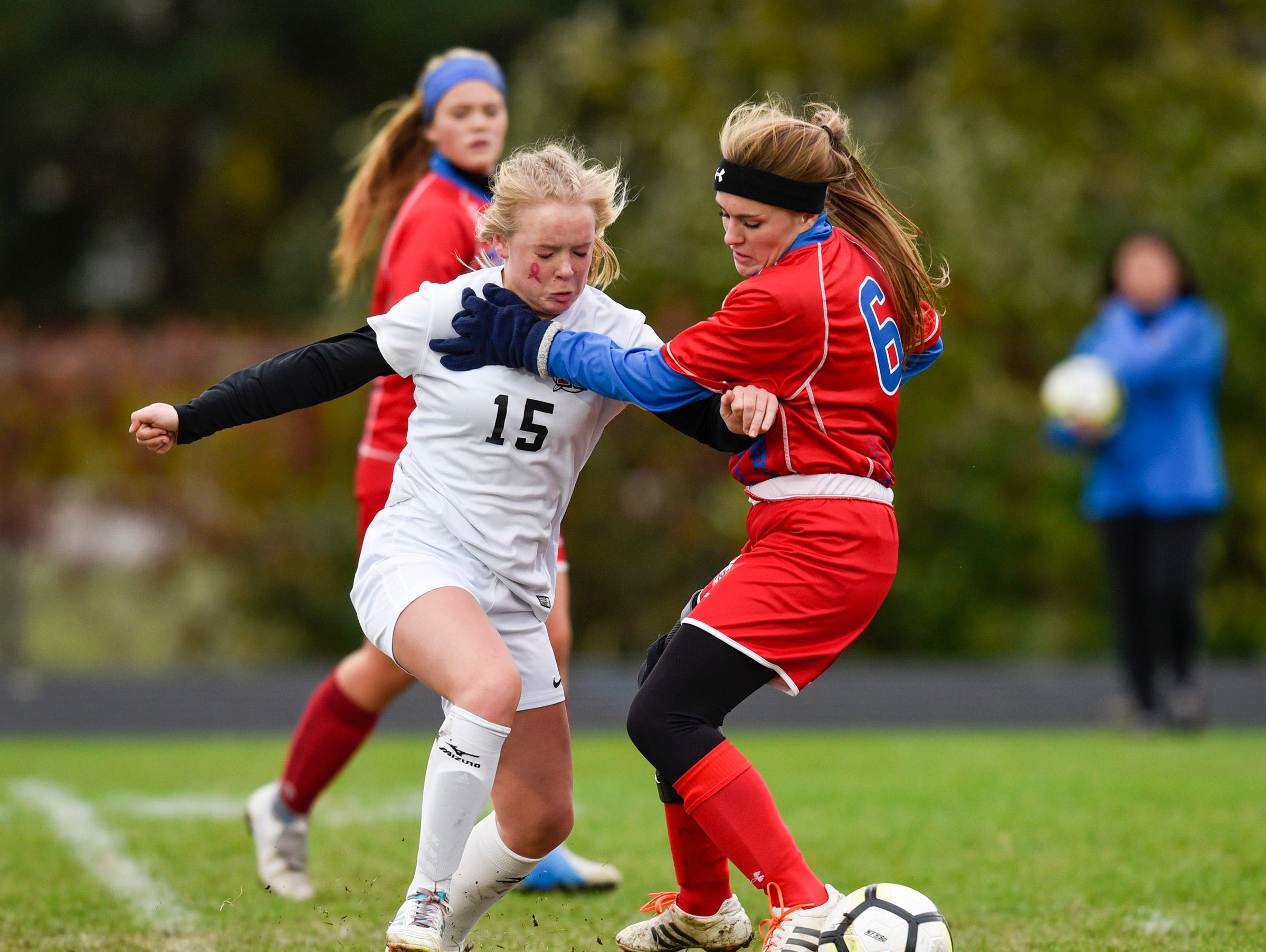 ROCORI's Delaney Griffin tries to take the ball past Apollo's Skyler Urick during the first half Thursday, Oct. 11, at Apollo High School.