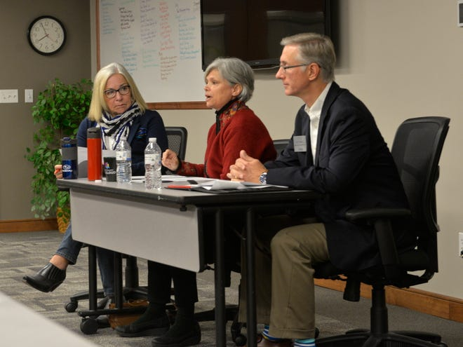 Stearns County board candidates Tarryl Clark and Steve Gottwalt respond to moderator Teresa Bohnen's questions during a candidate forum held Friday by the St. Cloud Area Chamber of Commerce.