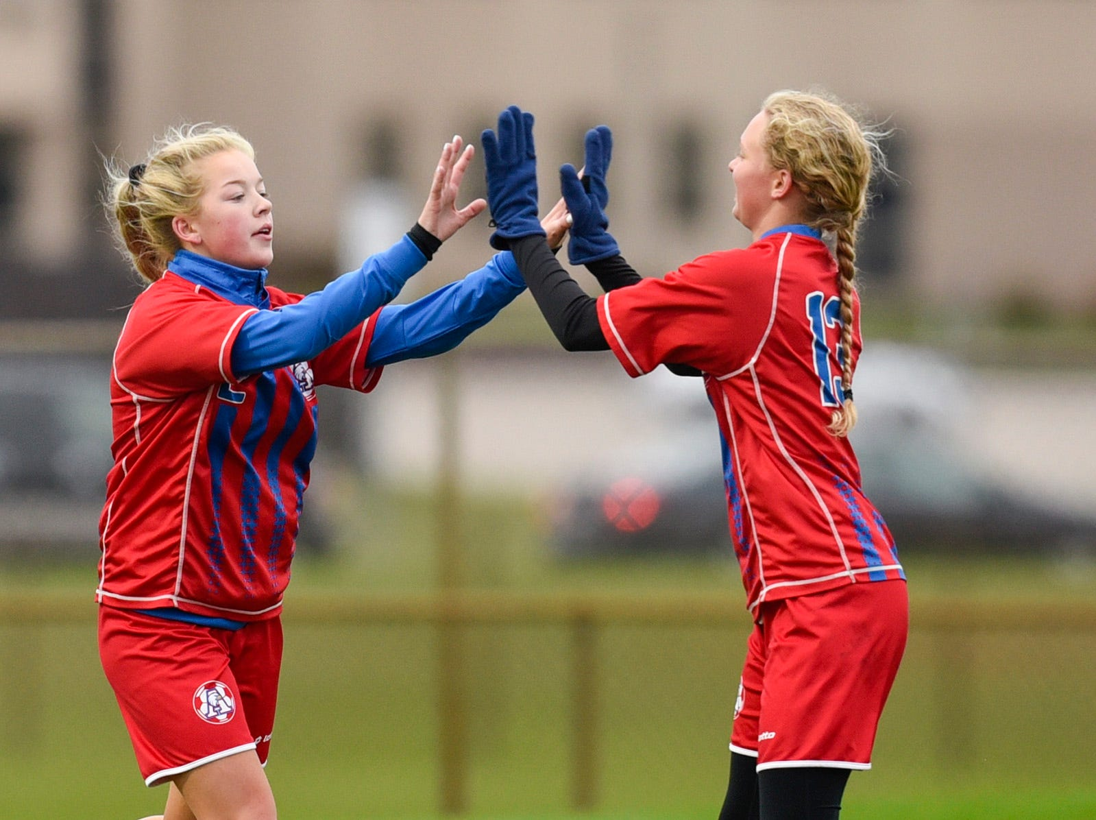 Apollo's Sofie Streich celebrates her first goal with Jessica Timpane against  ROCORI during the first half Thursday, Oct. 11, at Apollo High School.