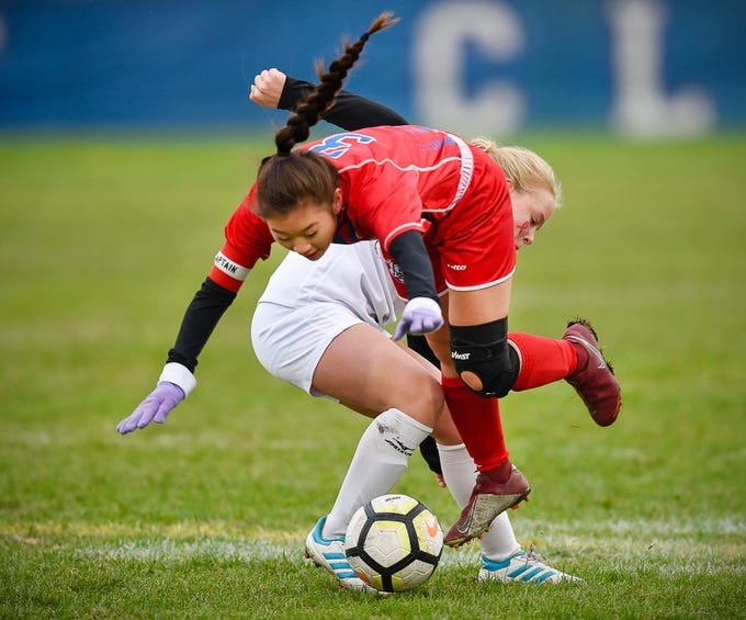 Apollo's Emilee Logeman goes over ROCORI's Delaney Griffin as they collide going for the ball during the first half Thursday, Oct. 11, at Apollo High School. Apollo won 5-0.