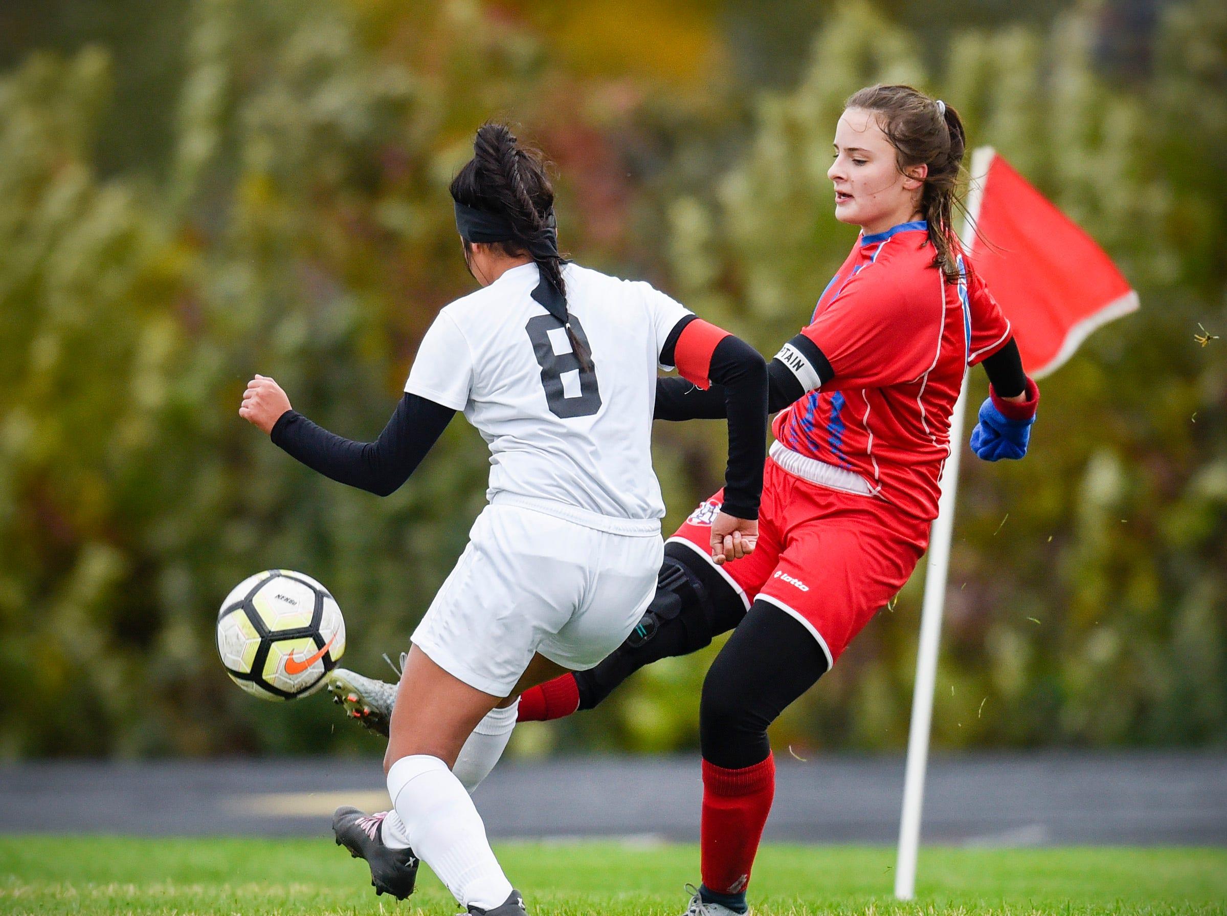 Apollo's Erica Thell kicks the ball past ROCORI's Jessica Salas during the first half Thursday, Oct. 11, at Apollo High School.