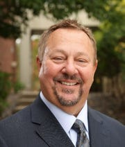 Dr. Ken Holmen