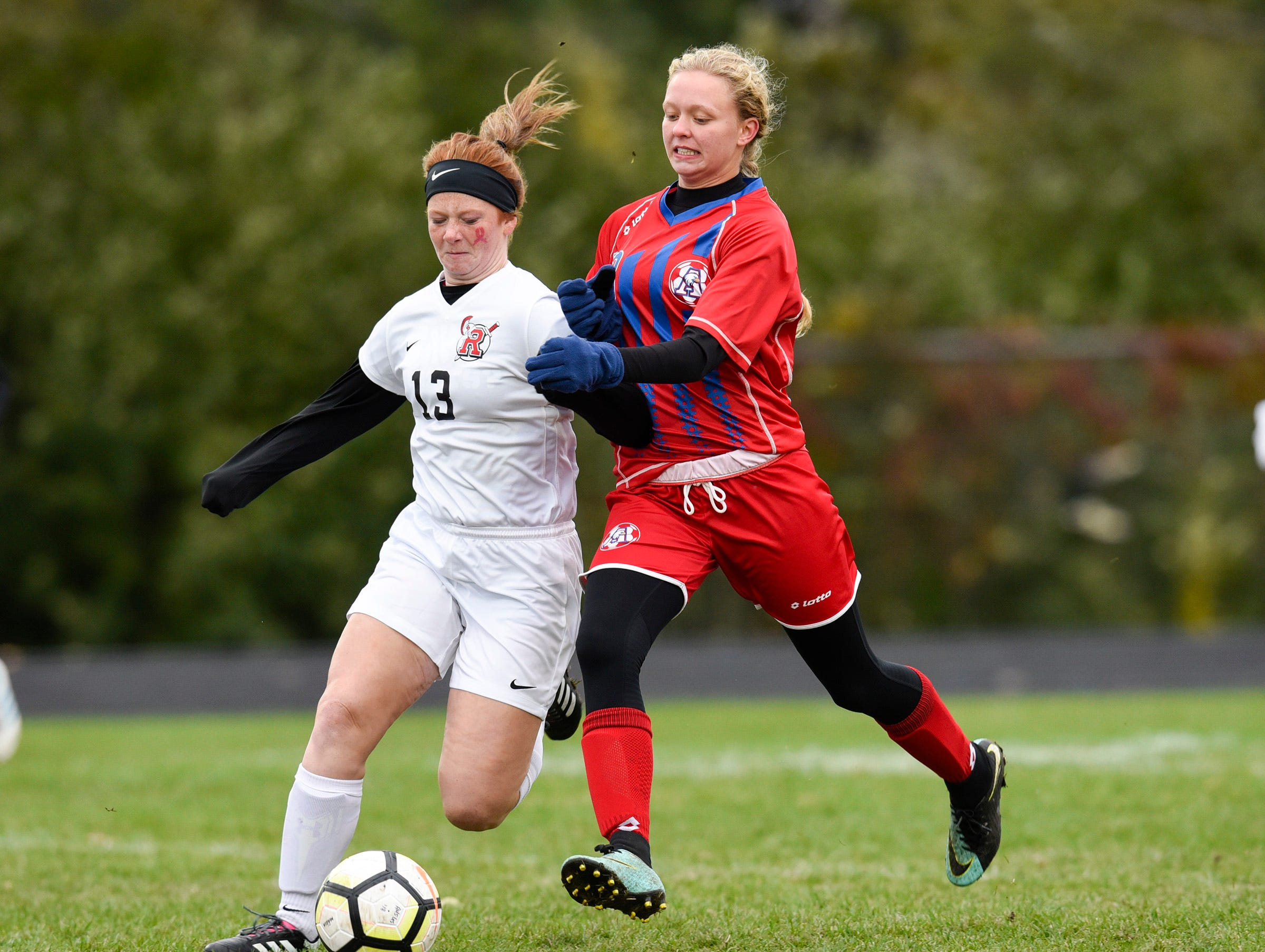 ROCORI's Bree Griffin tries to keep the ball from Apollo's Jessica Timpane during the first half Thursday, Oct. 11, at Apollo High School.