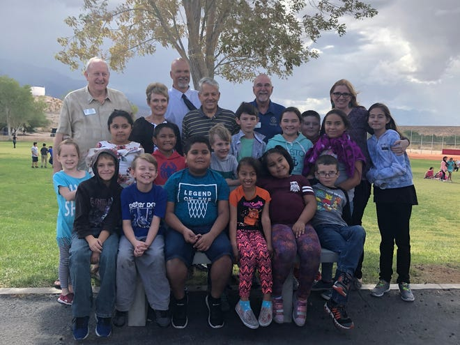 Rotary Club members join Beaver Dam Elementary Principal Lisa Young and students at the unveiling of the school's Buddy Bench on Oct. 10, 2018.