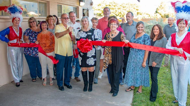 Members of the Mesquite Chamber of Commerce join founder Jean Watkins  at the ribbon cutting for the Mesquite Women's History and Culture Center.