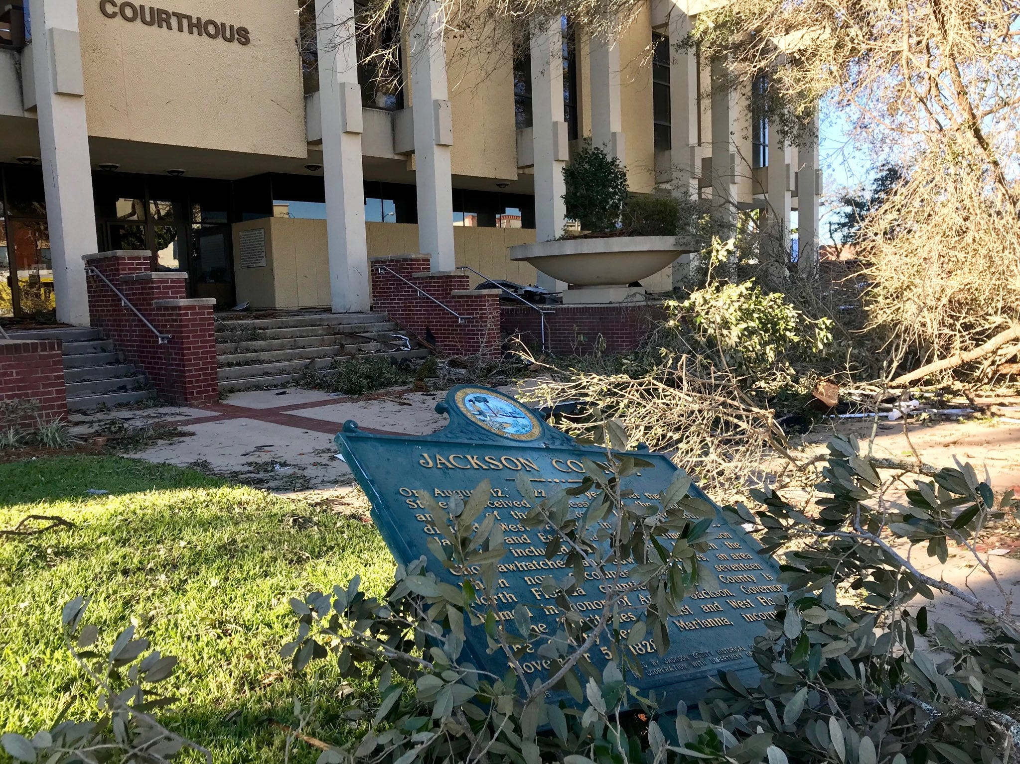Trees down, windows broken, Confederate monument damaged at the Jackson County Courthouse in Marianna.