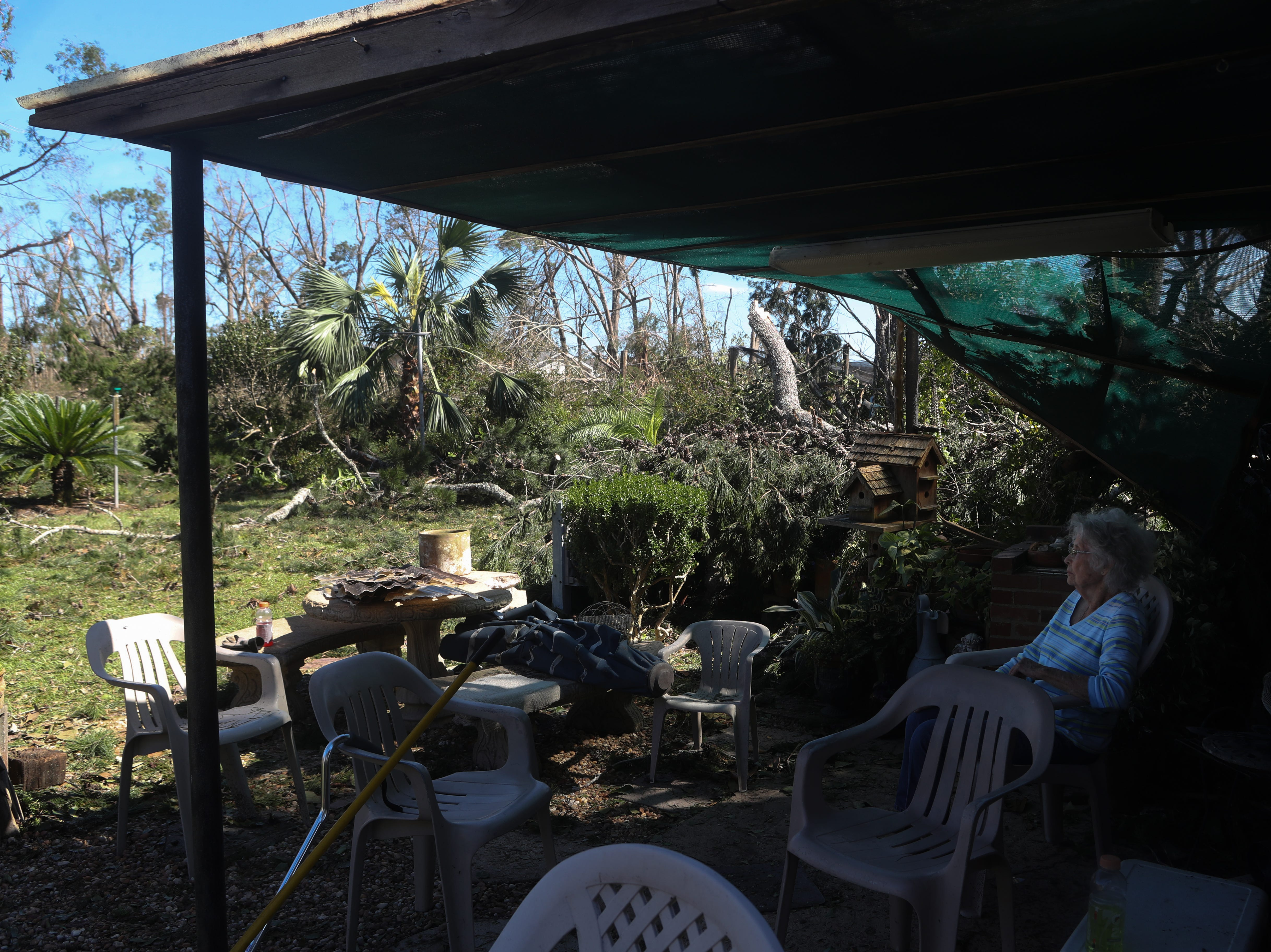 Doris Glass looks at the mess in her backyard in Blountstown, Fla. in the aftermath of Hurricane Michael Friday, Oct. 12, 2018.