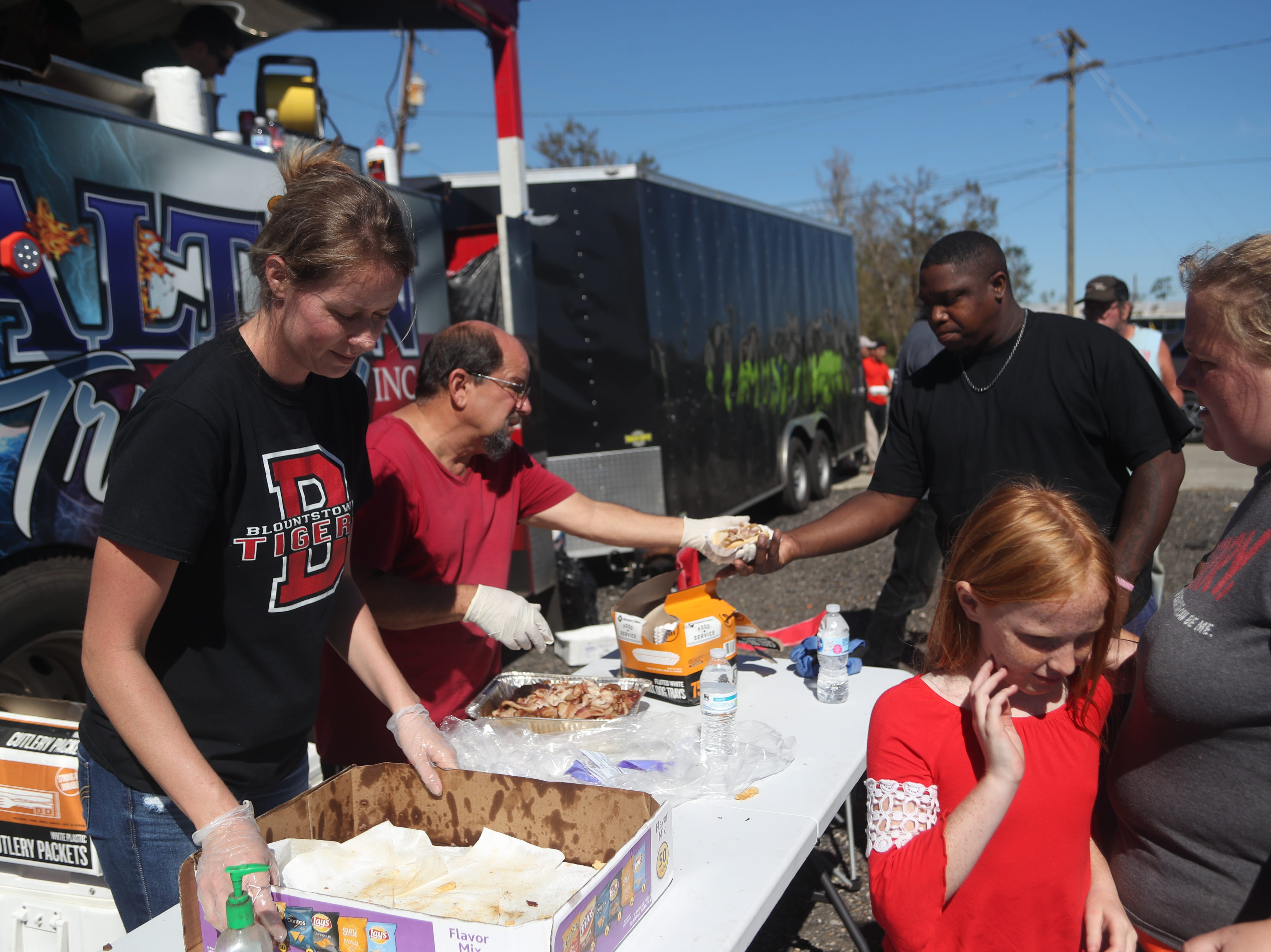 Dalton Trucking Inc. brings food to those in Blountstown, Fla. and Calhoun County in the aftermath of Hurricane Michael Friday, Oct. 12, 2018.