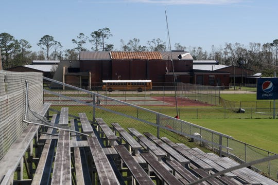The roof of Blountstown High School in Blountstown, Fla. is missing in the aftermath of Hurricane Michael Friday, Oct. 12, 2018.