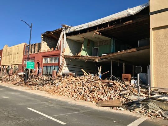 Hurricane Michael ripped roofs and facades off downtown Marianna buildings.
