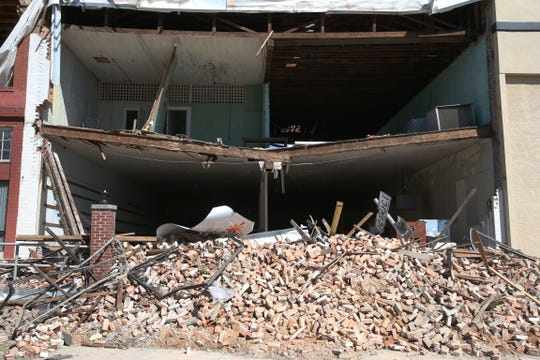 At a vacant business located in downtown Marianna, Fla. on Friday, Oct. 12, 2018, the front wall was left as a pile of bricks and wood after Hurricane Michael rips through the panhandle.