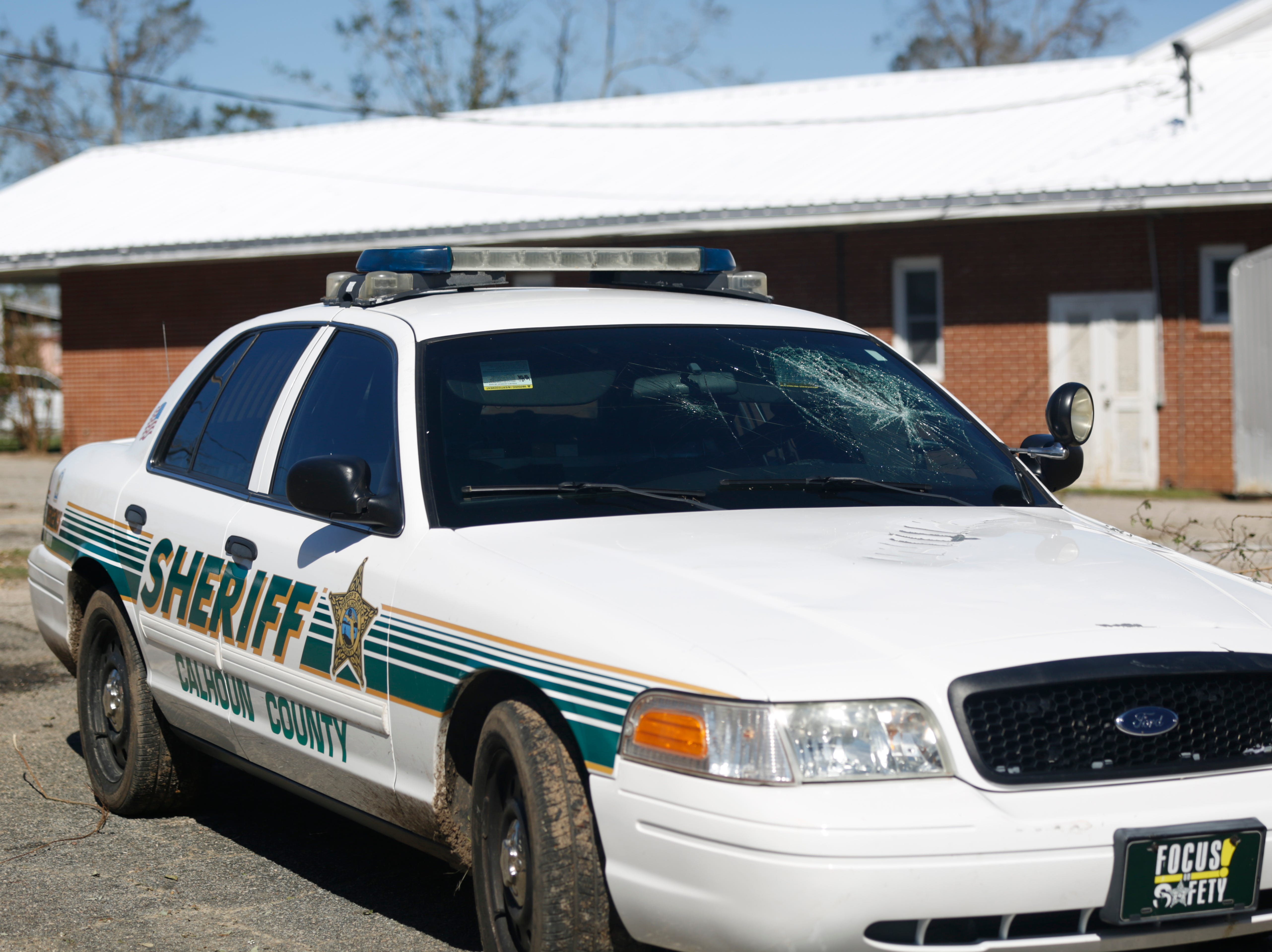 A Calhoun County Sheriff's car is damaged in Blountstown, Fla. in the aftermath of Hurricane Michael Friday, Oct. 12, 2018.