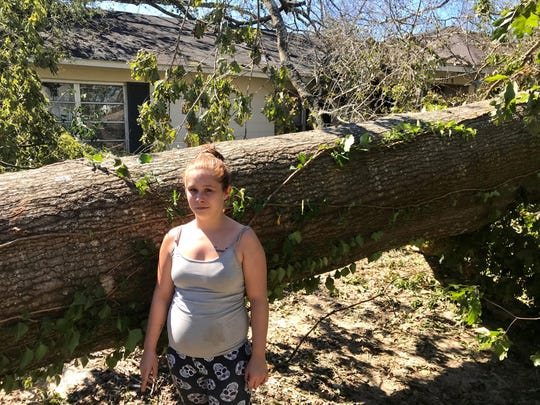 Breanna Massey narrowly escaped this house in Marianna after trees fell on the roof and in the yard.