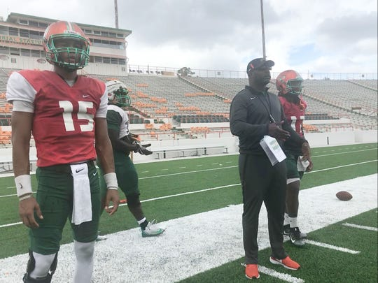 FAMU head coach Willie Simmons calls in plays during practice.