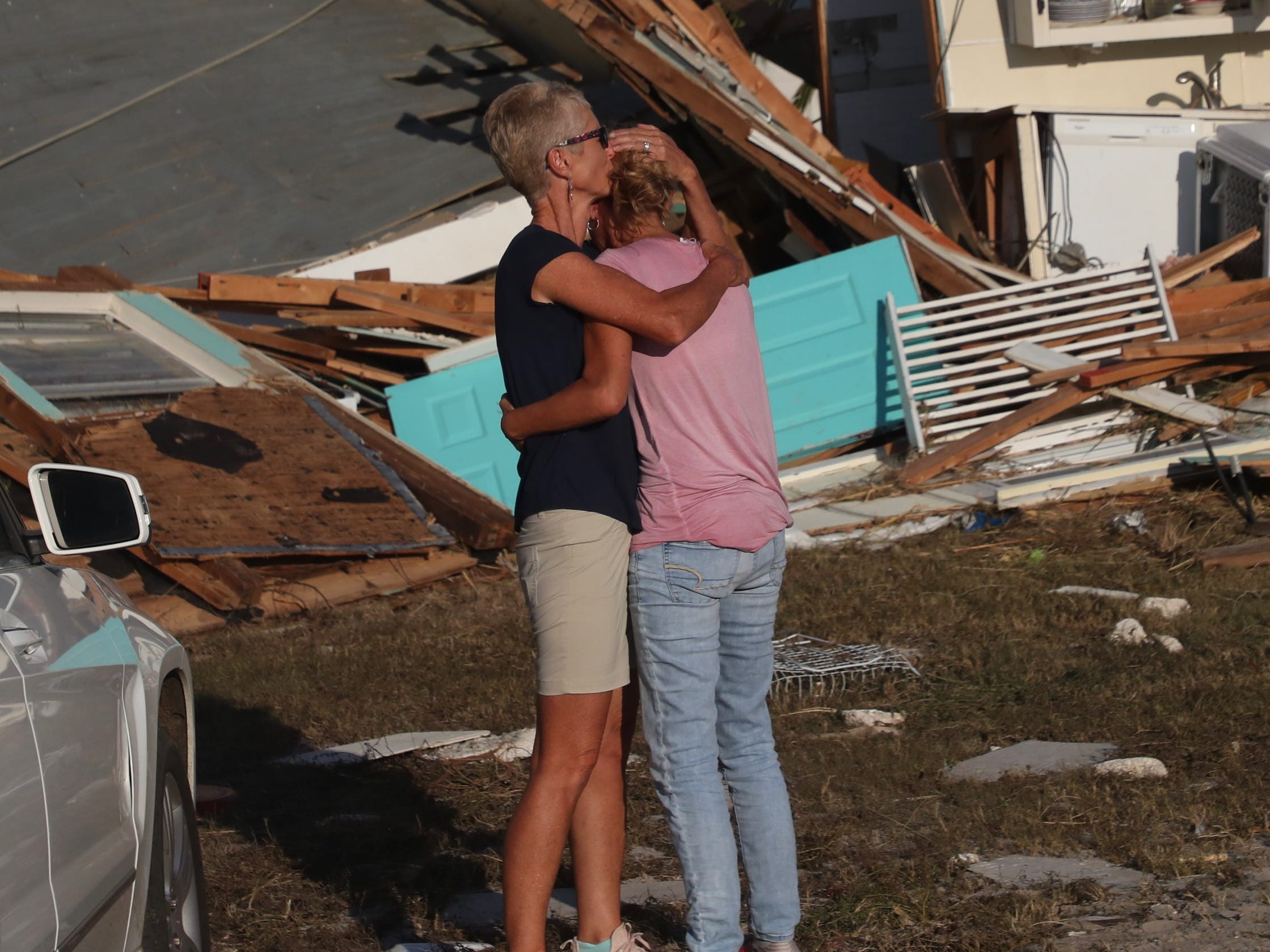 Becky Daniel hugs her wife Monica Barber as they drive up to see what is left of their Beacon Hill, Fla., home. It is next to Mexico City. It was ground zero for Hurricane Michael.