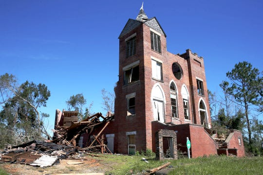 St. Luke's Baptist Church in Marianna, Fla. on Friday, Oct. 12, 2018, is left with shattered stained glass windows, missing doors and a pile of bricks after Hurricane Michael rips through the panhandle.