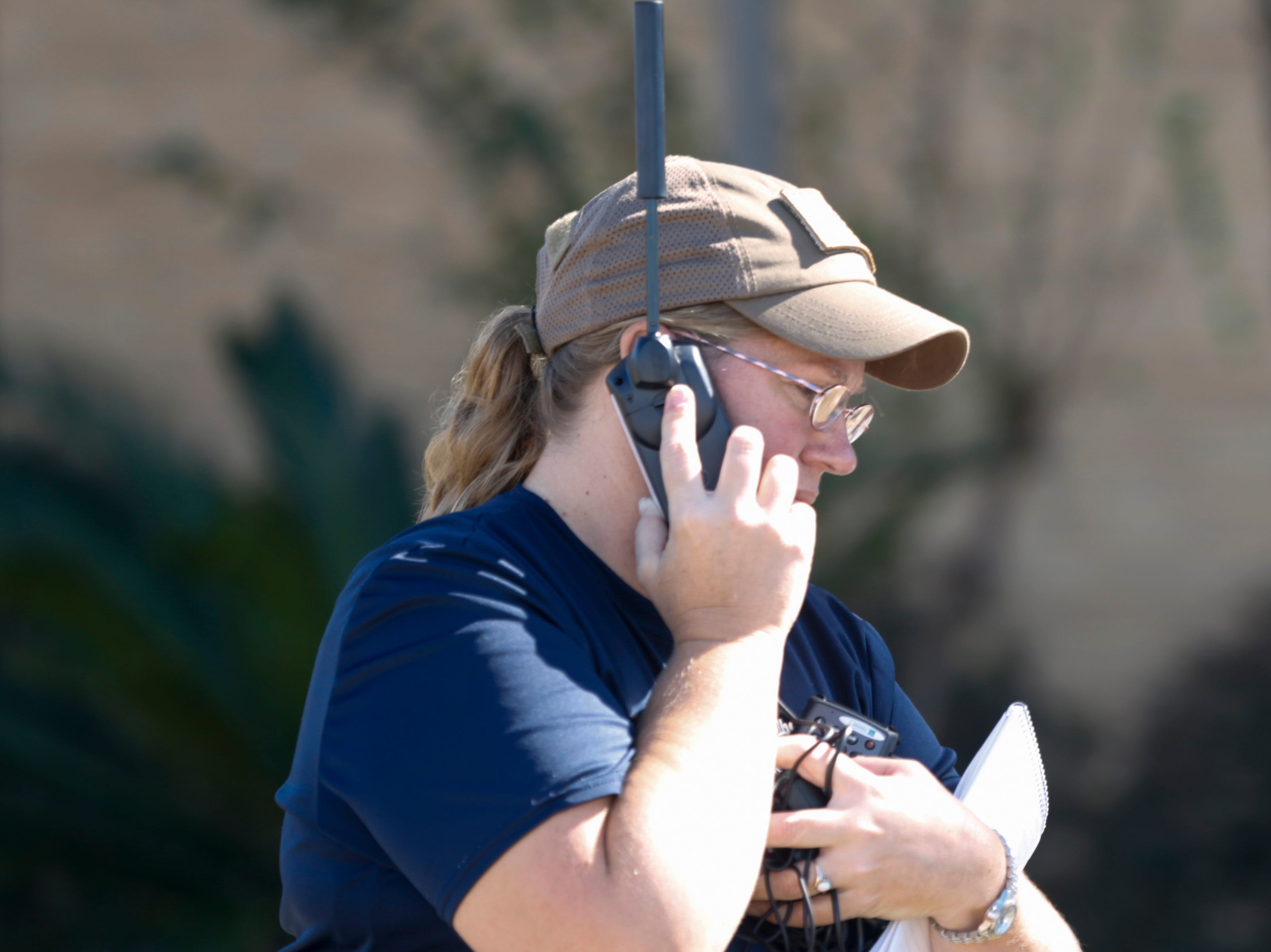 Calhoun County EMS employee Tammy Terry works a satellite phone at the Calhoun County Courthouse in Blountstown, Fla. in the aftermath of Hurricane Michael Friday, Oct. 12, 2018.