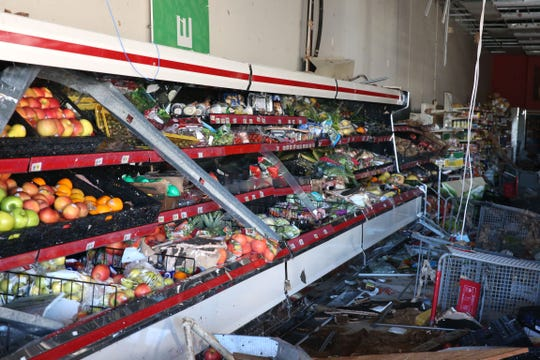 At the Oak Station shopping plaza in Marianna, Fla. on Friday, Oct. 12, 2018, store fronts are left in disarray after Hurricane Michael rips through the panhandle.