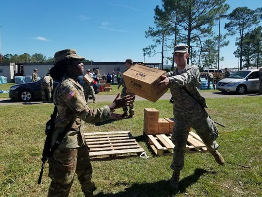 National Guard soldiers load ready-to-eat meals for residents at the Gadsden County Jail, where a distribution site was set up following Hurricane Michael's beating on the Big Bend Oct. 10, 2018.