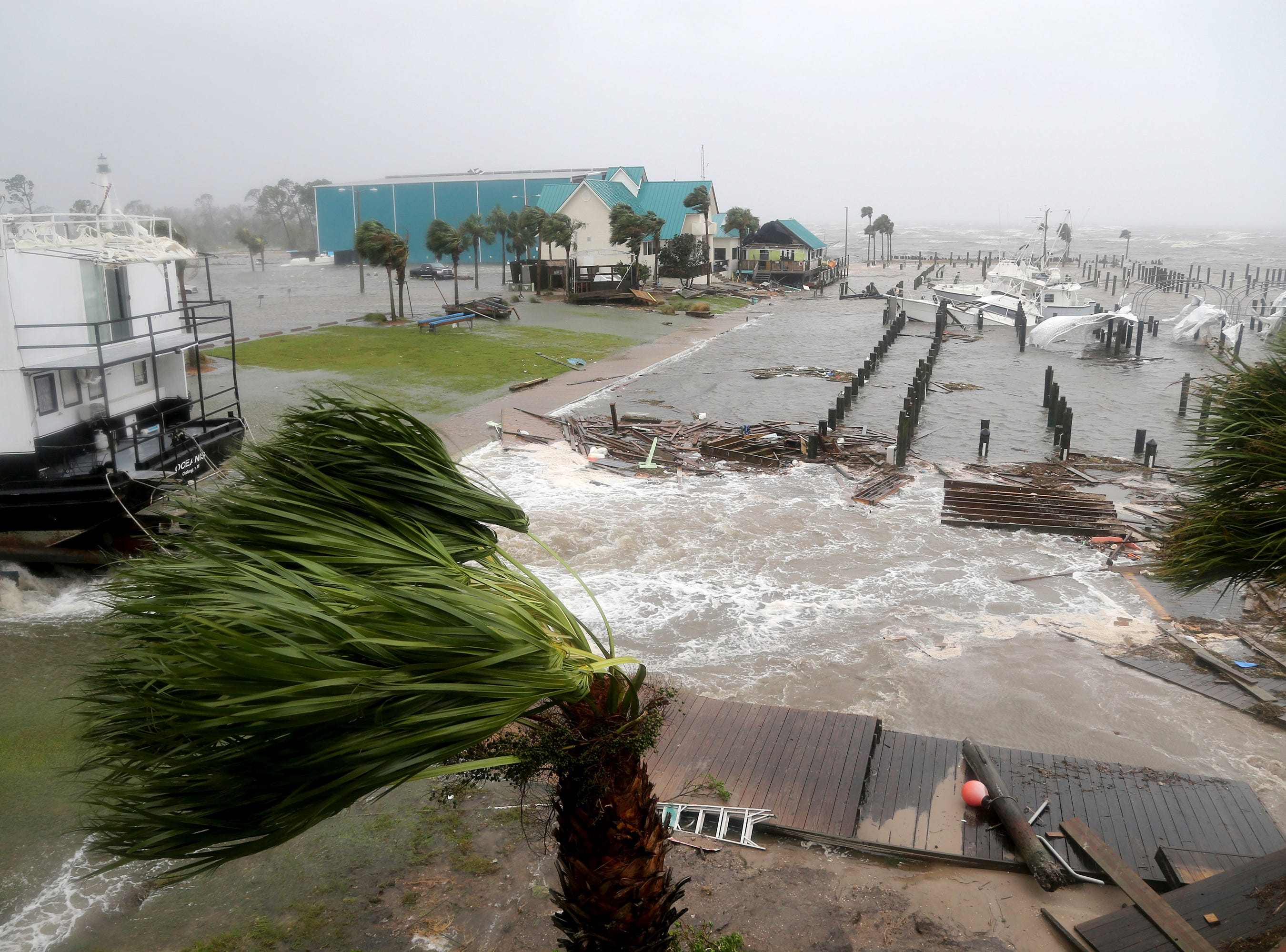 Boats lay sunk and damaged at the Port St. Joe Marina, Wednesday, Oct. 10, 2018 in Port St. Joe, Fla. Supercharged by abnormally warm waters in the Gulf of Mexico, Hurricane Michael slammed into the Florida Panhandle with terrifying winds of 155 mph Wednesday, splintering homes and submerging neighborhoods. (Douglas R. Clifford/Tampa Bay Times via AP)