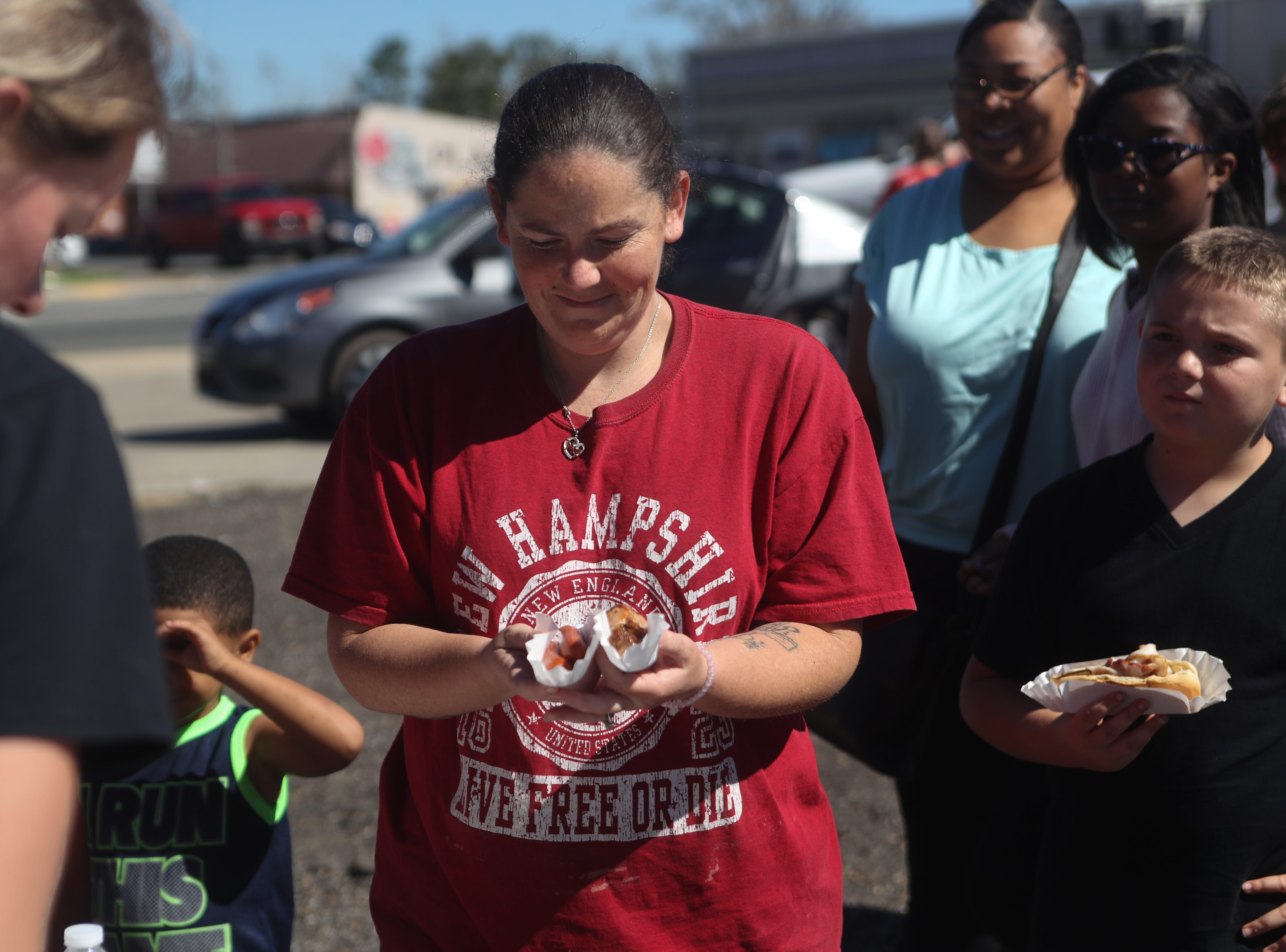 Shanna Russ gets food for herself and her children from Dalton Trucking Inc. in Blountstown, Fla. in the aftermath of Hurricane Michael Friday, Oct. 12, 2018.