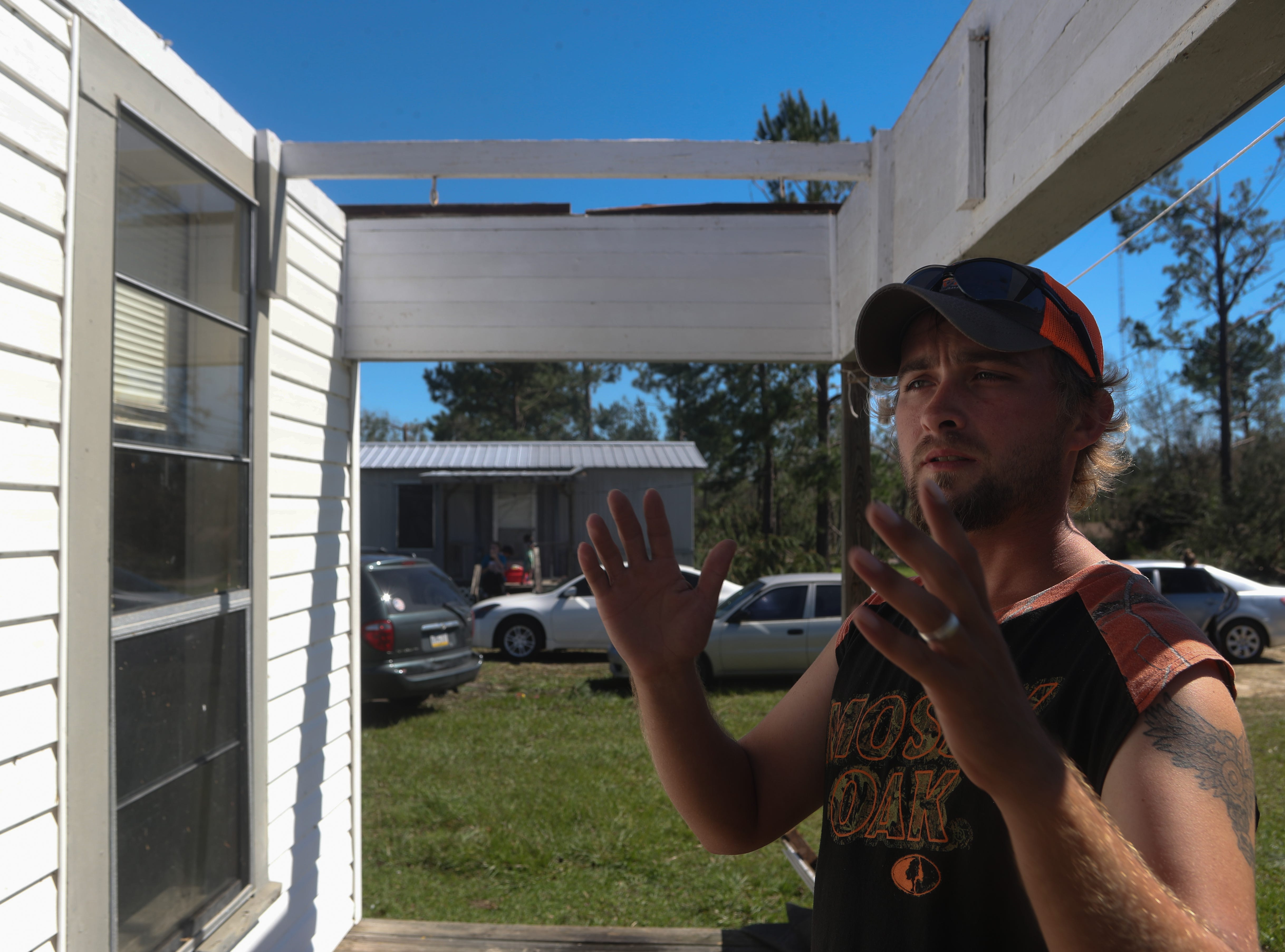 Caleb Hoffman reflects on the loss of the roof of his home in Blountstown, Fla. in the aftermath of Hurricane Michael Friday, Oct. 12, 2018. Hoffman and his young family moved to Blountstown from Pennsylvania only eight months ago.