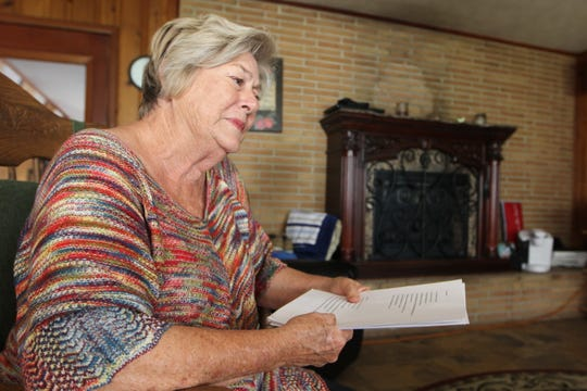 Shirley Revell, 75, cries as she holds a poem she wrote about her husband James David Revell on Friday, Oct. 12, 2018, as she remembers the last hours she spent with James, who died during Hurricane Michael in their Greensboro home in Gadsden County. Hospice workers couldn't send to transport him to a funeral home because of the dangerous weather conditions until Thursday morning.