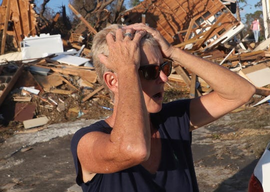 Becky Daniel reacts to seeing her Beacon Hill home next to Mexico City, Fla. The area was ground zero for Hurricane Michael.