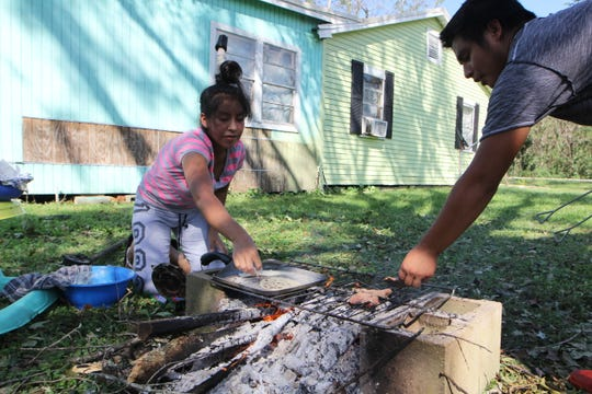 Magdalena Francisco and Julio Diego improvised after their power went out from Hurricane Michael's blusterous winds. The couple spent the afternoon of Thursday, Oct. 11, 2018 cooking cutlets and handmade tortillas on a makeshift grill — cinder blocks, firewood, an oven rack — as their 15-month-old son looked on.