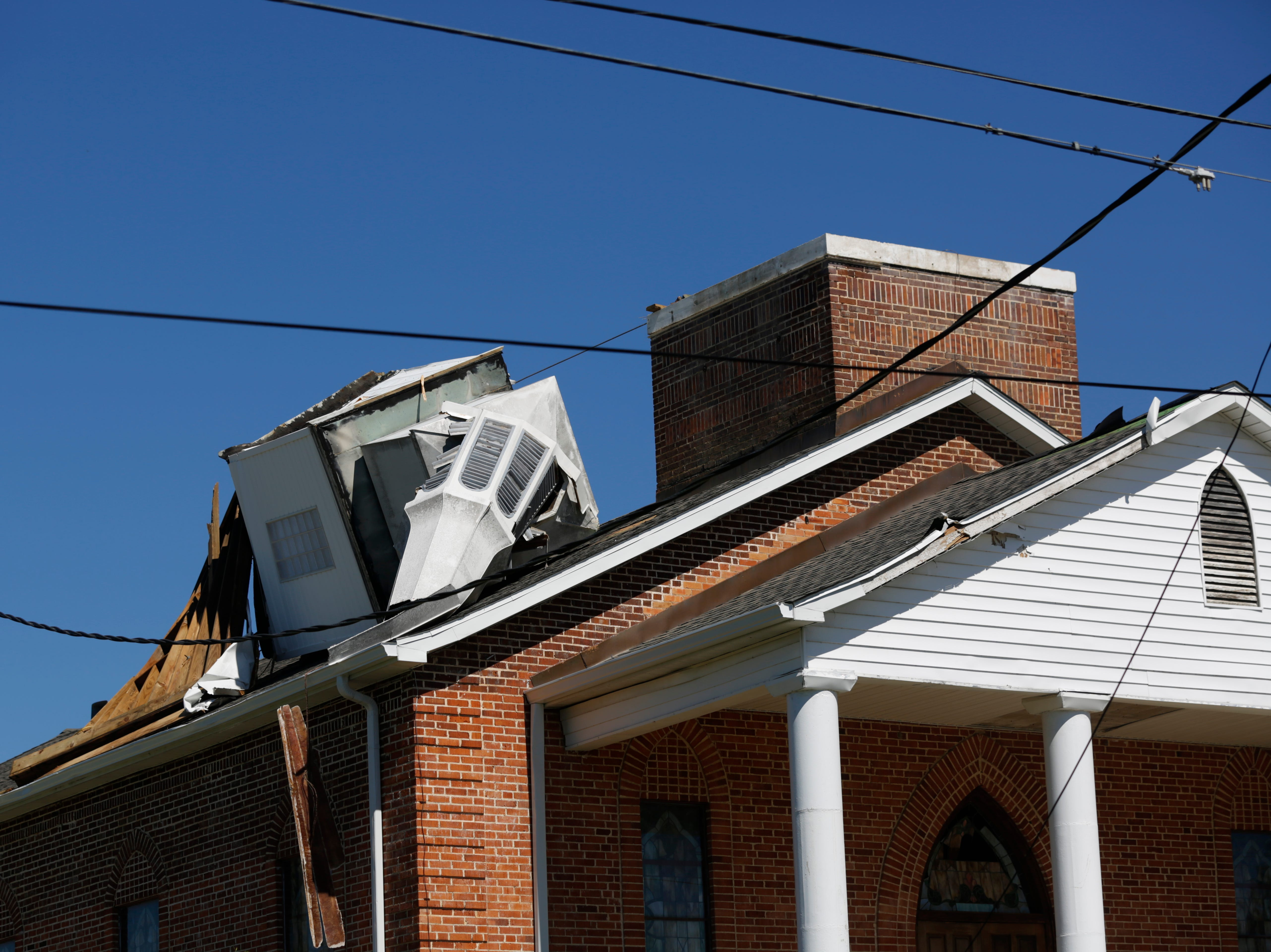 The steeple of Blountstown United Methodist Church in Blountstown, Fla. is destroyed in the aftermath of Hurricane Michael Friday, Oct. 12, 2018.