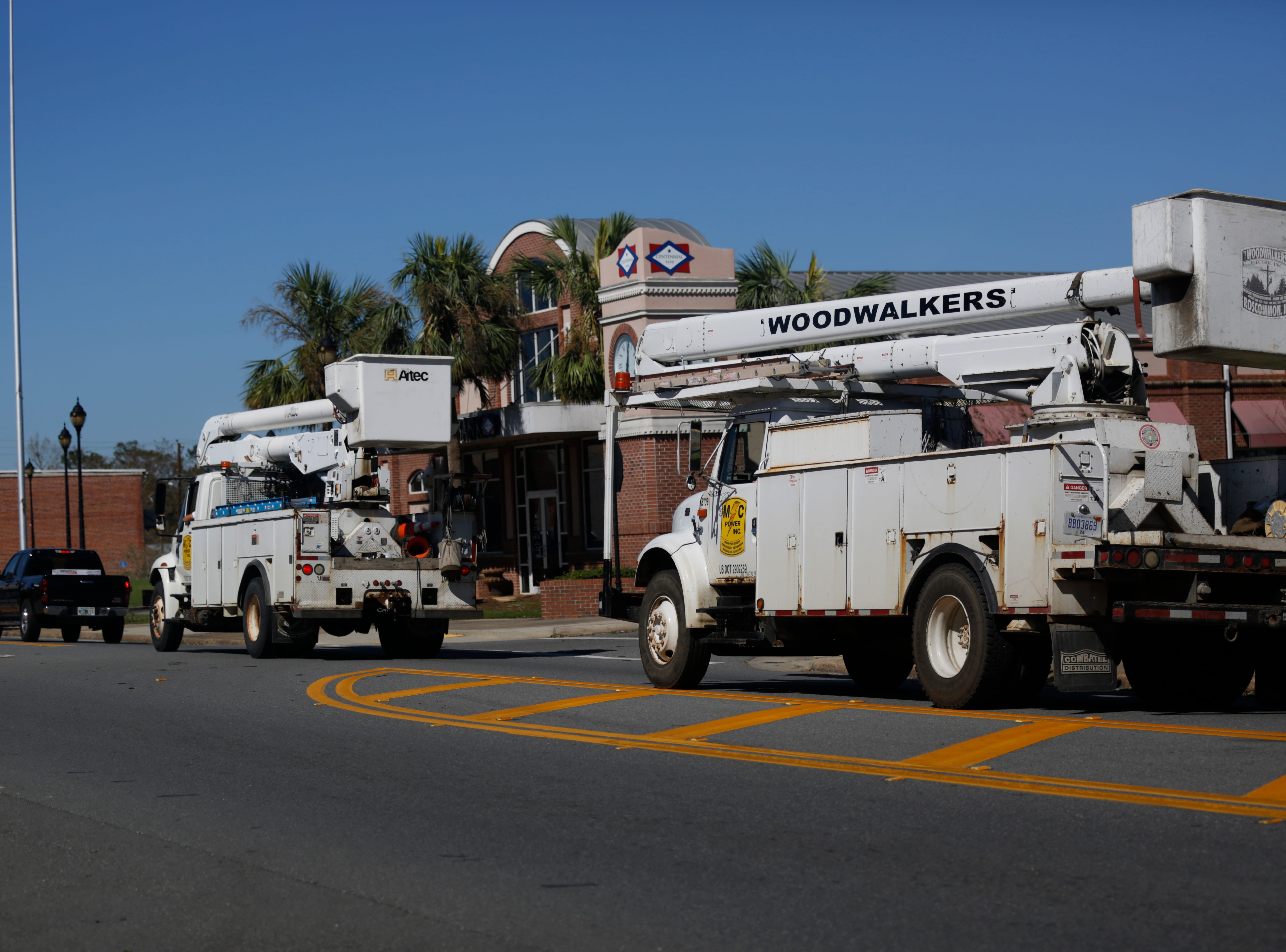 Trucks make their way to those without power across the Big Bend and Panhandle via Highway 20 in Blountstown, Fla. in the aftermath of Hurricane Michael Friday, Oct. 12, 2018.