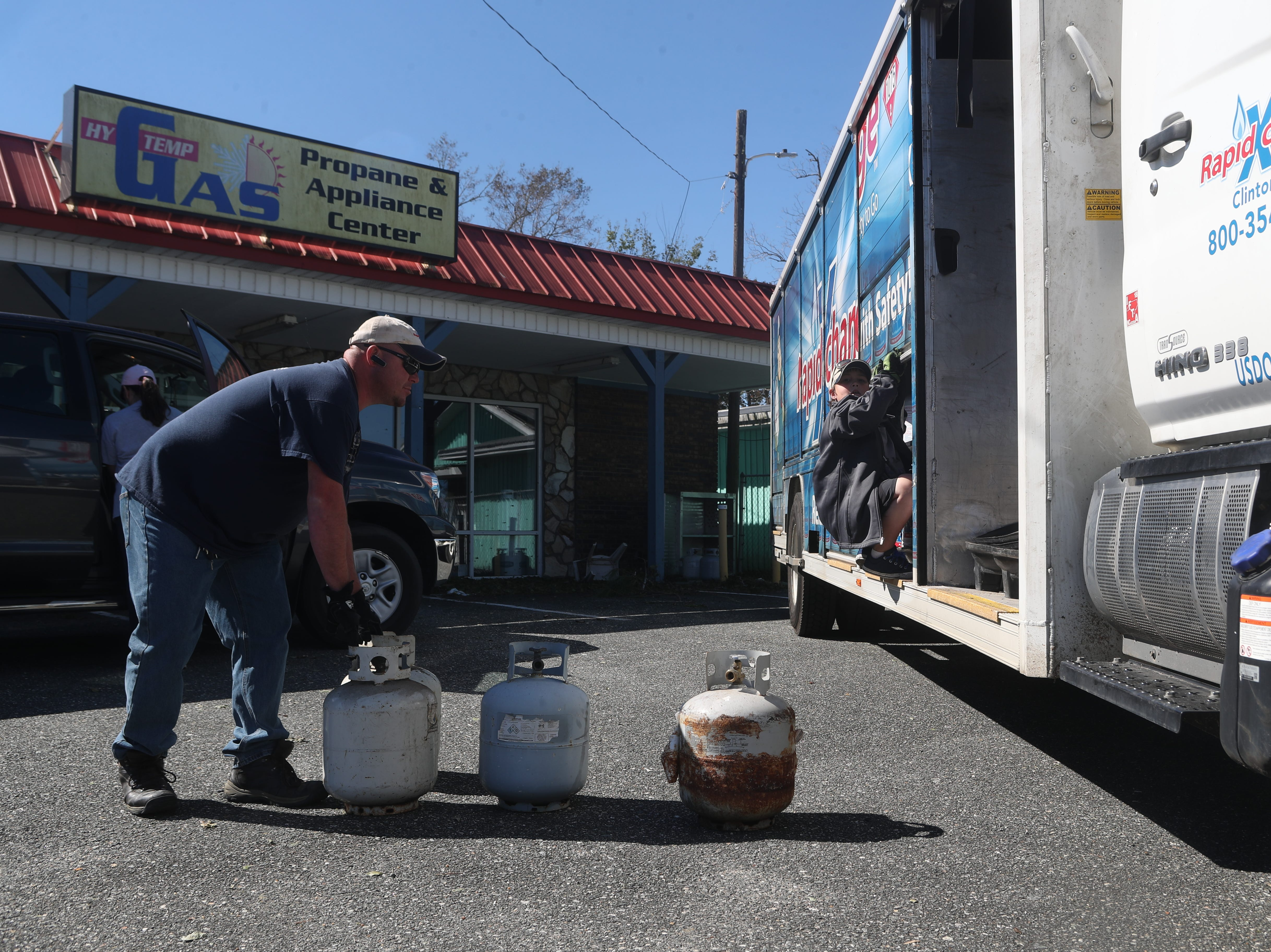 Trent Killingsworth and his son Trent, 10, deliver propane in Blountstown, Fla. in the aftermath of Hurricane Michael Friday, Oct. 12, 2018.