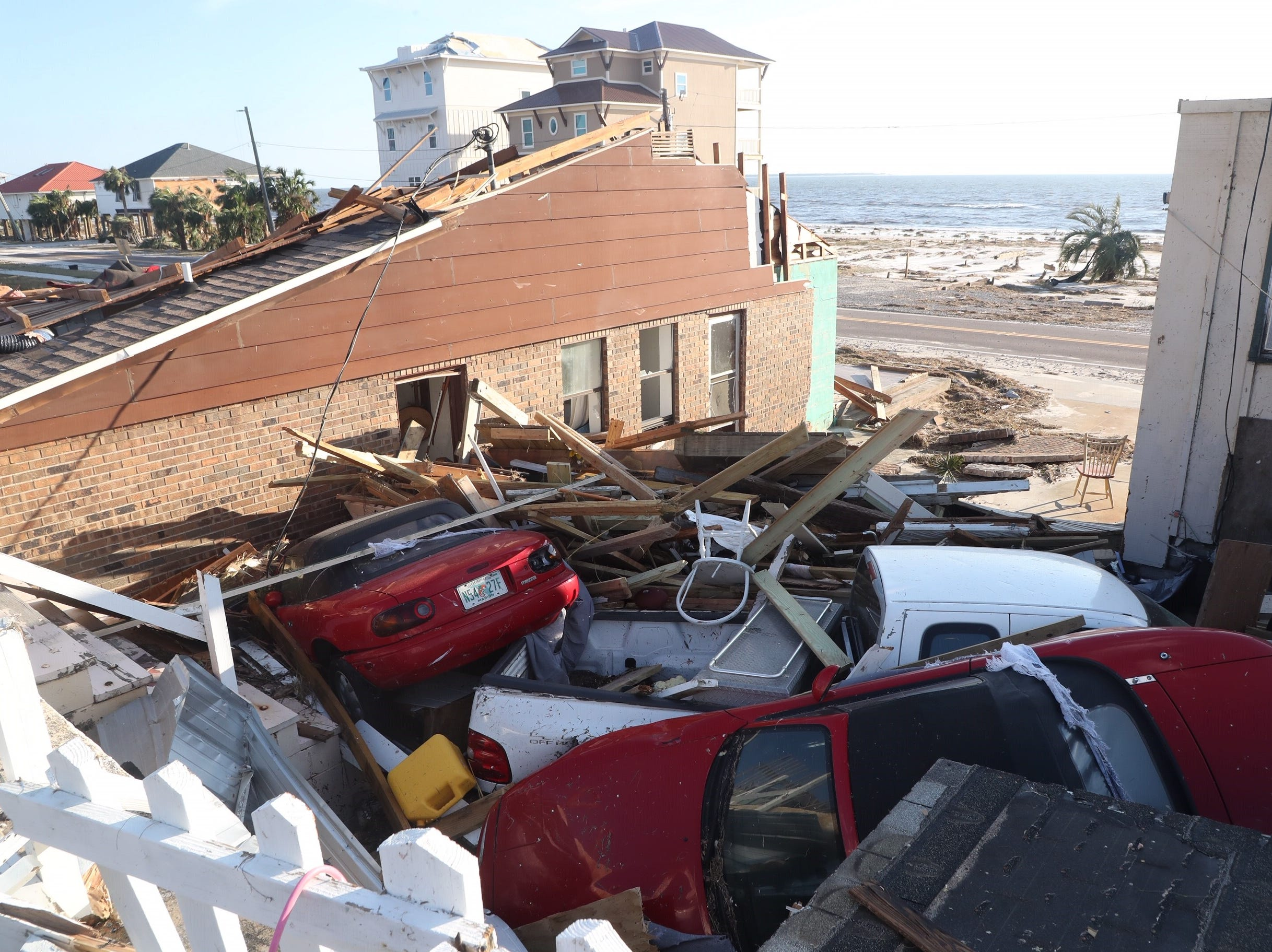 Three cars belonging to James and Cynthia Murphy lay in a pile of rubble after Hurricane Michael hit Mexico Beach.