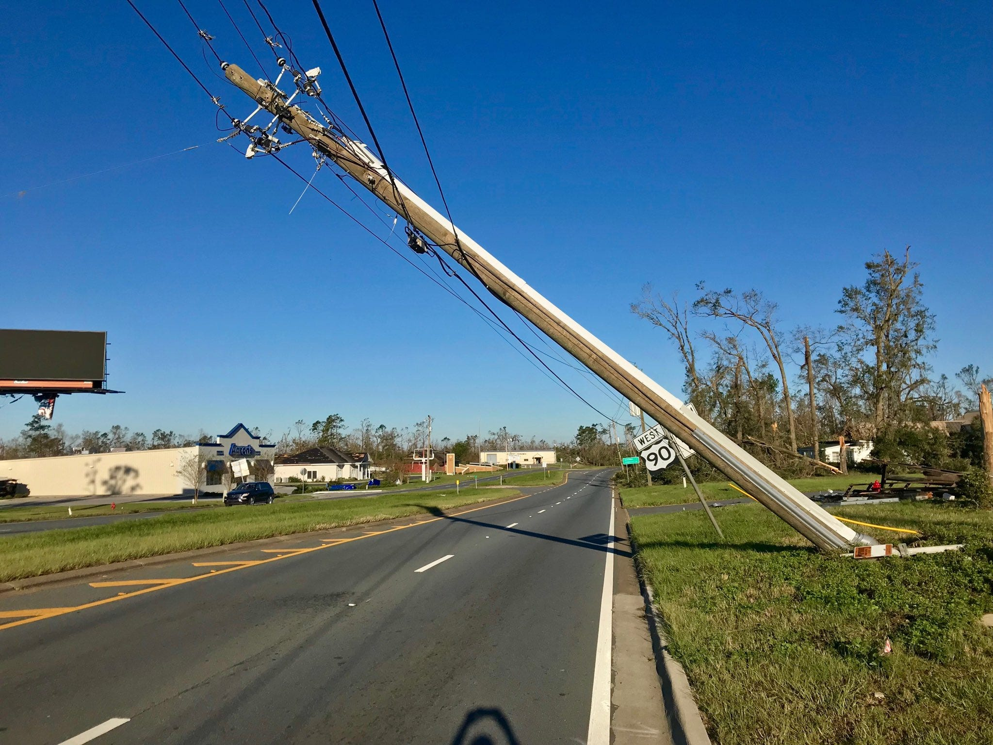 Power poles and lines are down everywhere in Marianna. Traffic lights are out and trees are blocking lanes of major roads.