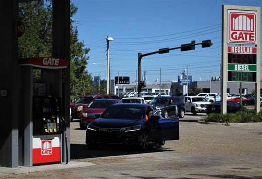 Vehicles line up at GATE Gas Station on N. Magnolia Drive to wait for fuel as Tallahassee residents cope with power loss and the need for generators in the wake of Hurricane Michael.
