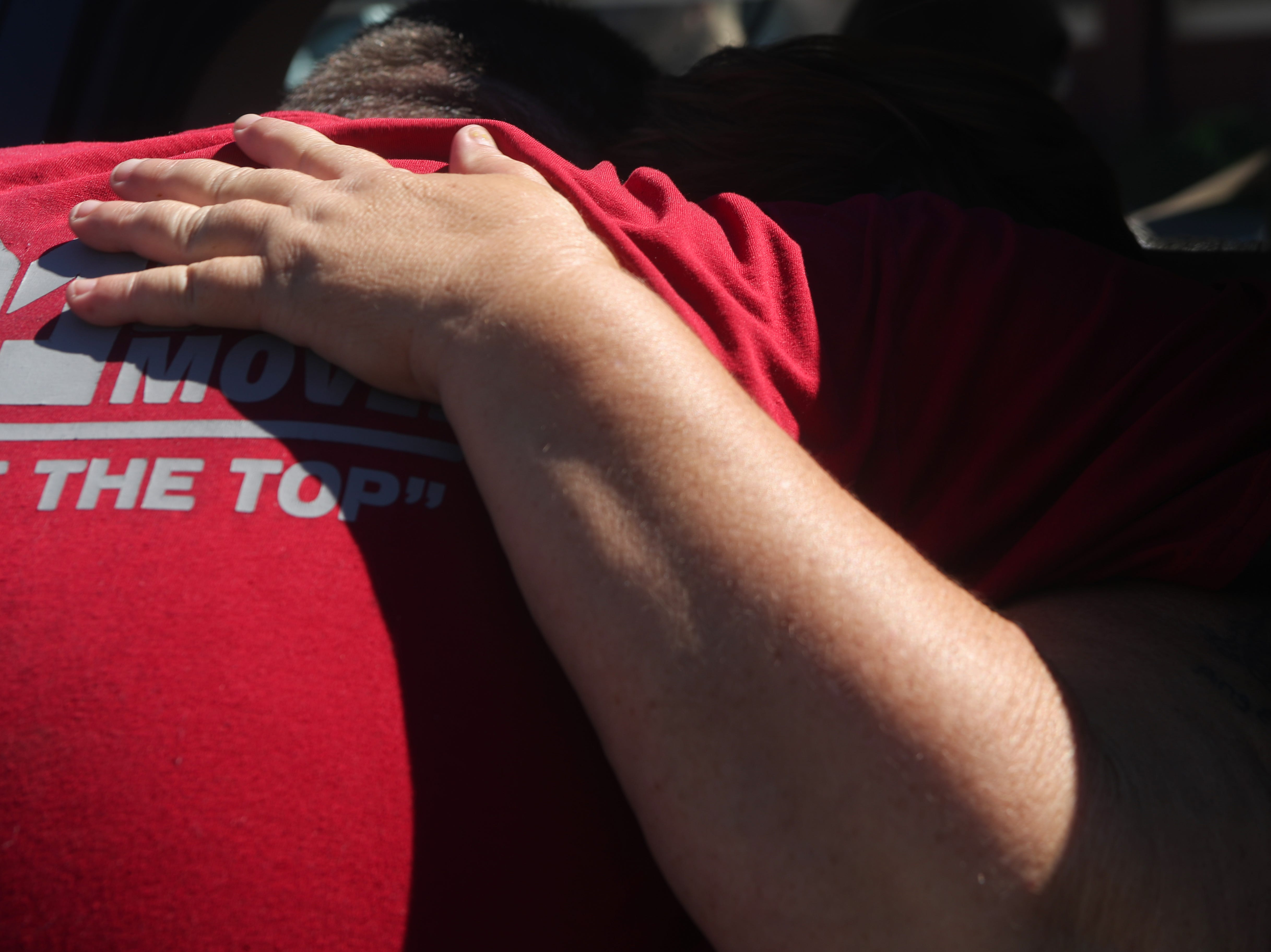 Kathy Drew hugs her son, an inmate at the Liberty County jail, as he works handing out American Red Cross blankets and cots at the Liberty County Emergency Operations Center in Bristol, Fla. in the aftermath of Hurricane Michael Friday, Oct. 12, 2018.