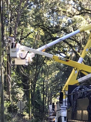 Lakeland Electric workers repair damage to lines on Centerville Road just north of Betton Road.