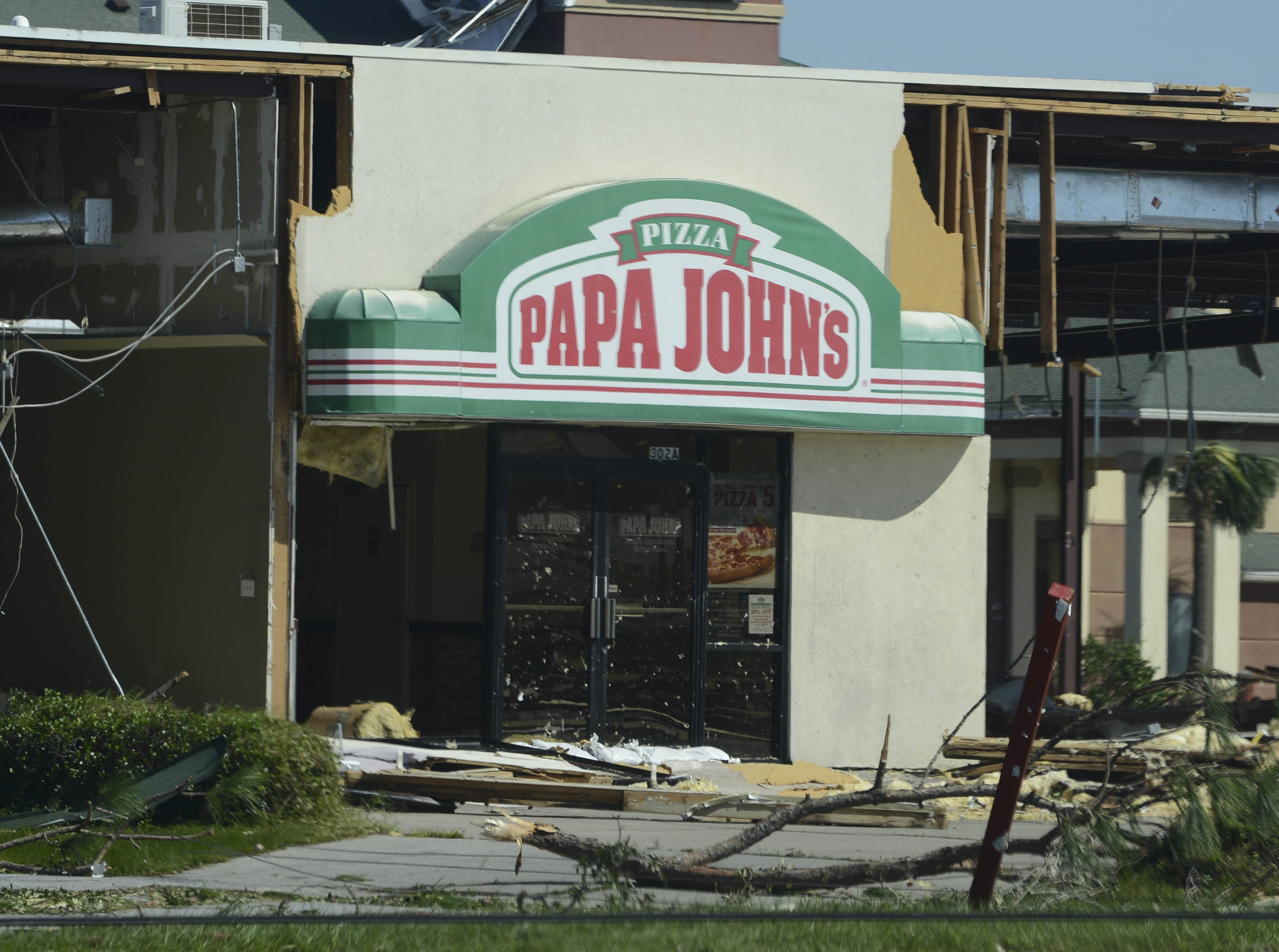 A building in Panama City, FL containing a Papa Johns pizza is completely destroyed by Hurricane Michael.