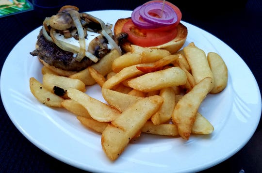The Tipsy Parrot's Blackened Blue Burger had generous melted blue cheese, grilled onions, and sauteed mushrooms. All sandwiches are served with crispy steak fries.