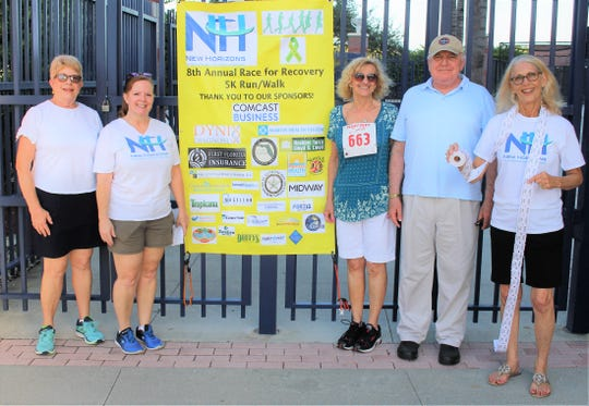 New Horizons Board Chair Pat Austin, left, Executive Assistant Karen Mike, Carole Romano, CEO John Romano, and Jo Anne Knight, chief human resources officer, at the Race for Recovery 5K Run/Walk at Mets Stadium/First Data Field.