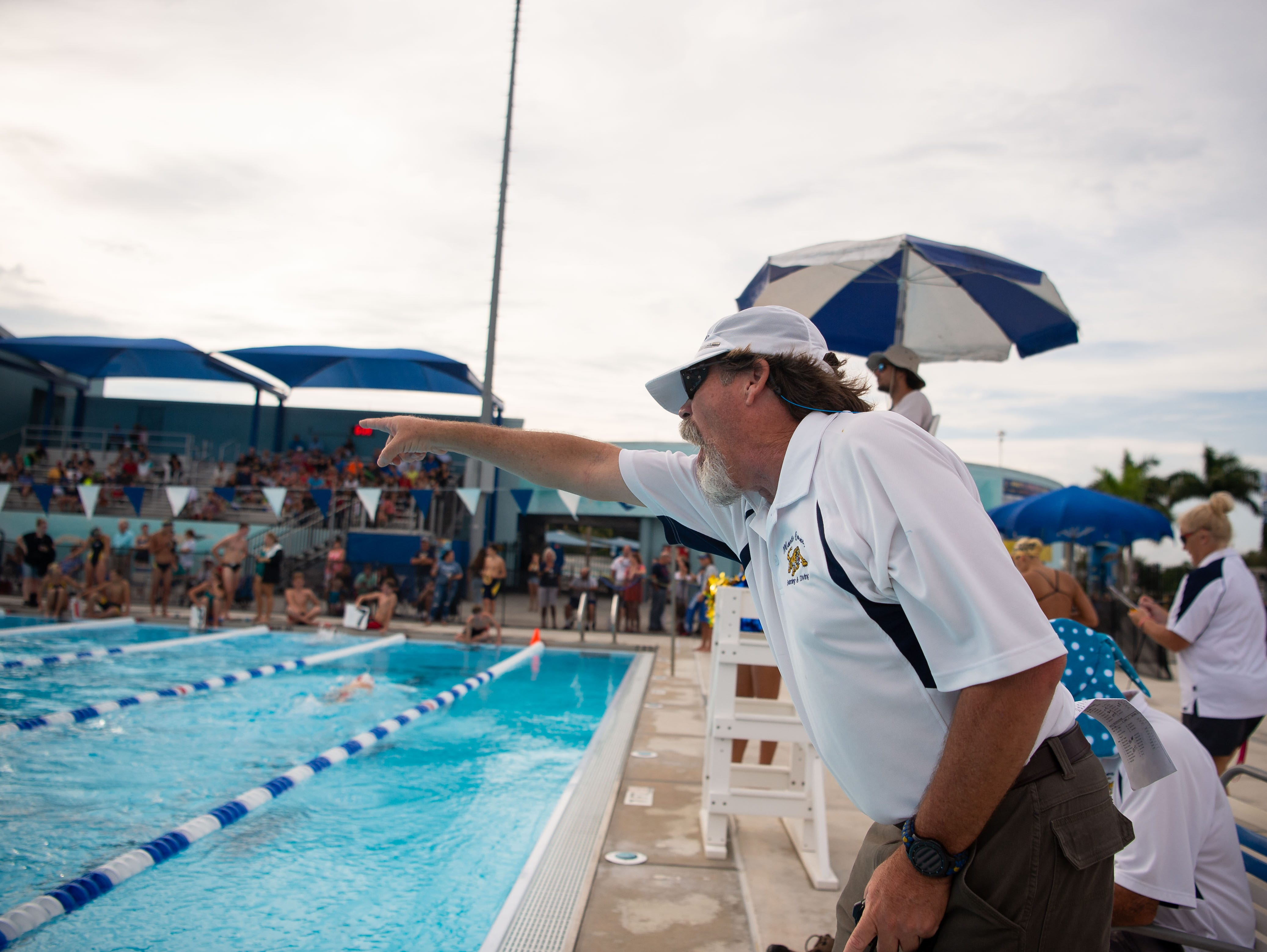 Martin County head coach Job McCombs motivates his simmers as schools compete at the Martin County Championships high school swim and dive meet Thursday, Oct. 11, 2018, at Sailfish Splash in Stuart.