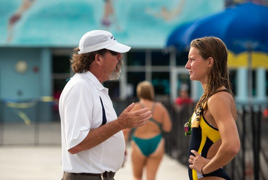Martin County coach Jim McCombs talks with swimmer Delaney Simpkins as schools compete at the Martin County Championships high school swim and dive meet Thursday, Oct. 11, 2018, at Sailfish Splash in Stuart. Simpkins has placed in the top eight at state in sboth print freestyle events each of the past three years.
