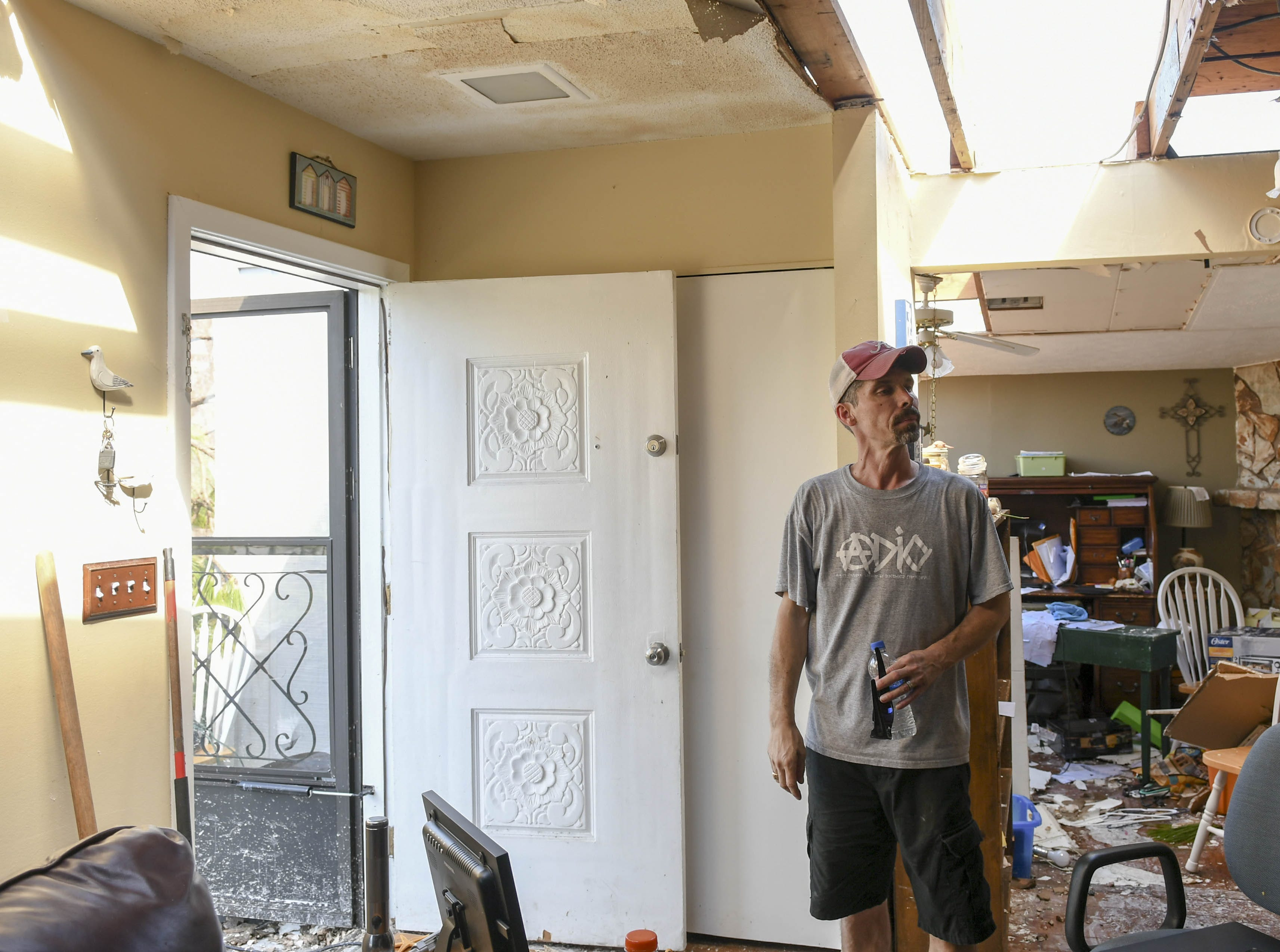 Michael Brown of Panama CIty describes what happened during Hurricane Michael. Part of his roof was removed and cars damaged by the storm.