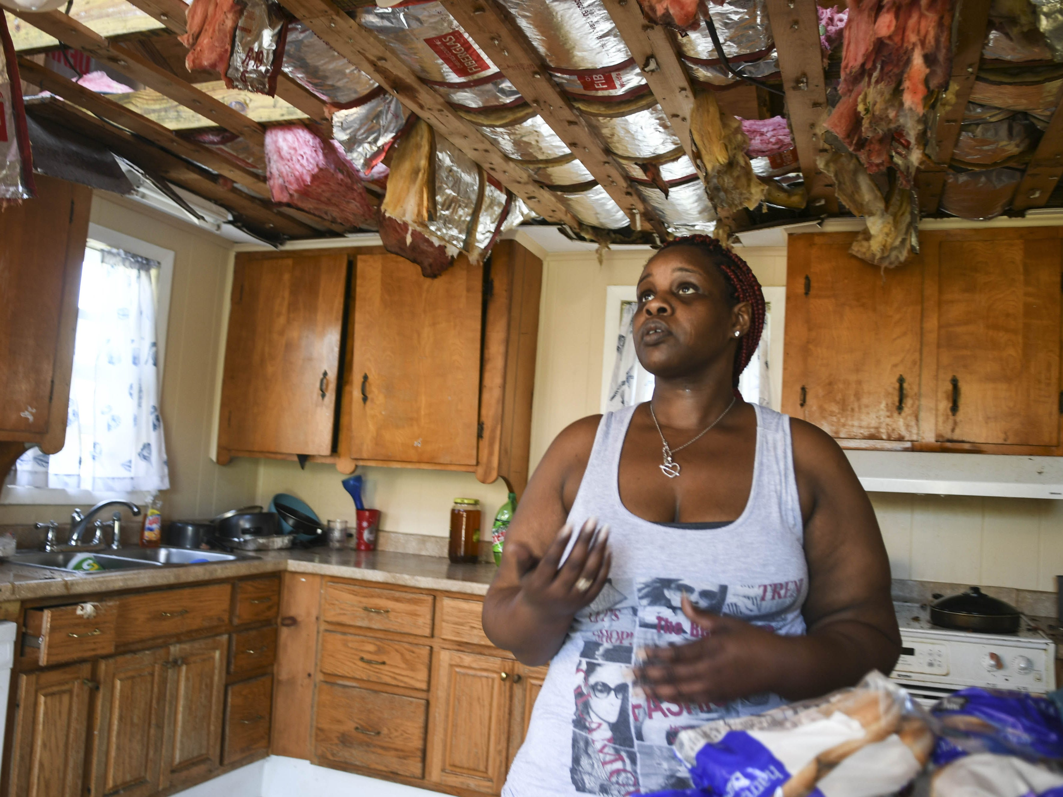 Sheila Dukes stands in the ruined kitchen of her rental house in Panama City, FL. Hurricane Michael tore the roof off, flooding the entire wooden structure.