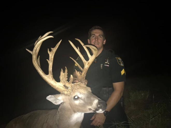 Martin County sheriff's Sgt. Kevin Kryzda with the buck before the buck was poached.