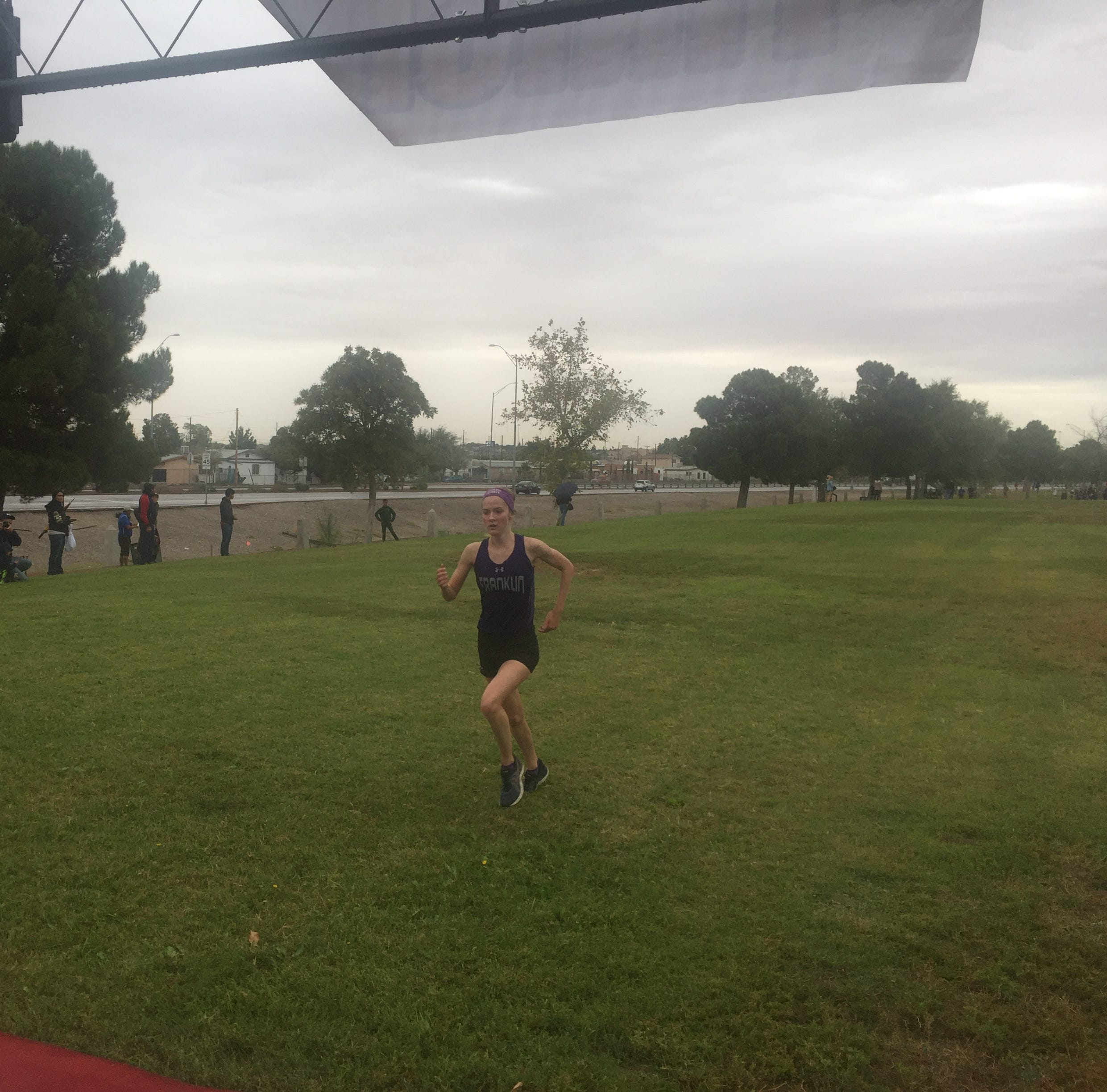 Franklin's Eva Jess wins the District 1-6A girls cross-country title Friday.
