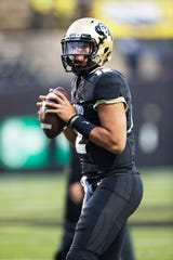 Colorado Buffaloes quarterback Steven Montez (12) warms up before an NCAA college football game Friday, Sept. 28, 2018, in Boulder, Colo.